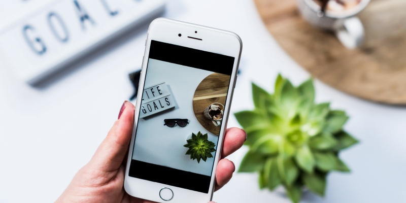 Taking photo with mobile phone for business social media