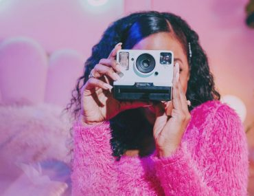 What to post on Instagram - woman with camera