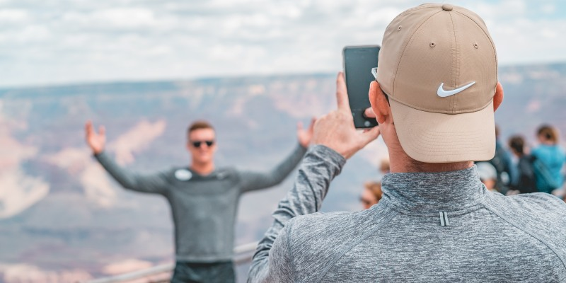 Man taking a photo with phone