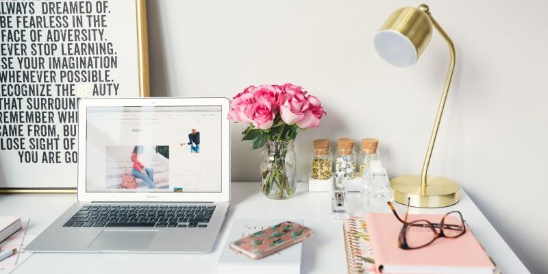 Social media expert desk setup with laptop