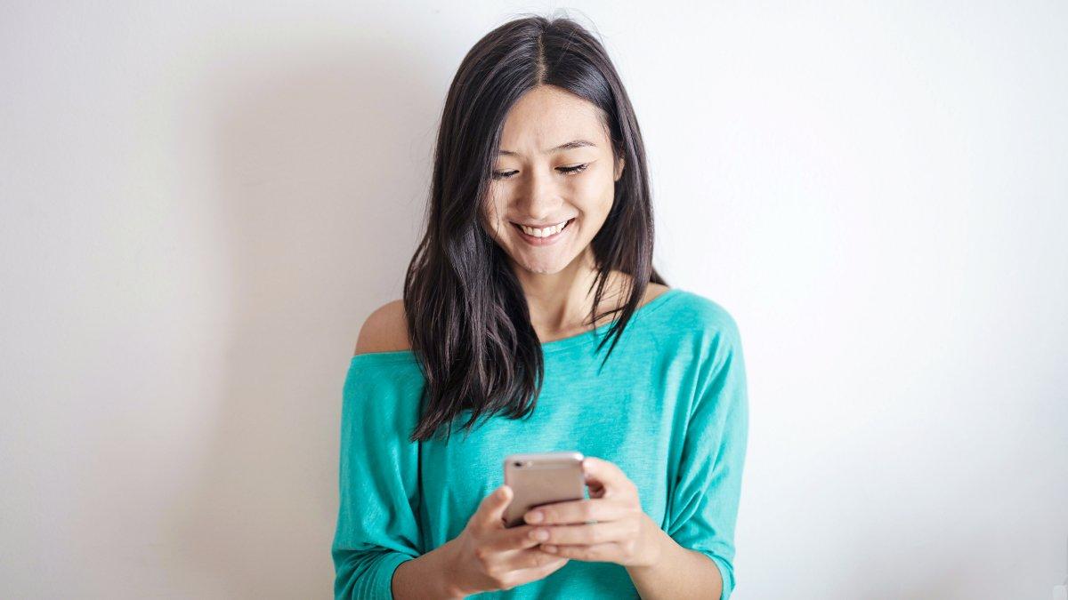 Woman looking happy at phone