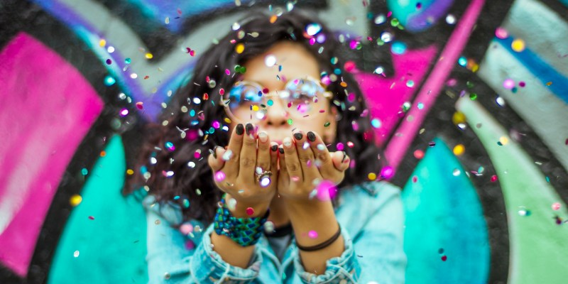 contest winner blowing confetti
